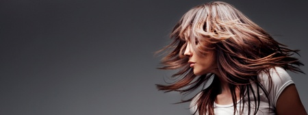 woman profile with hair in motion, panoramic photo photo