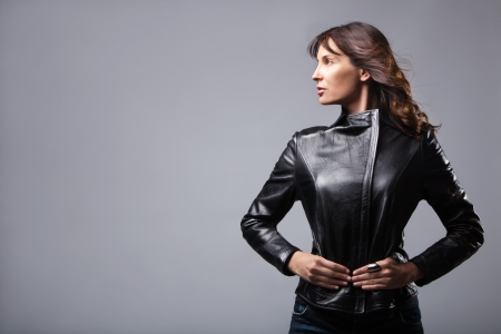 leather jacket: adult woman in black leather jacket, studio shot