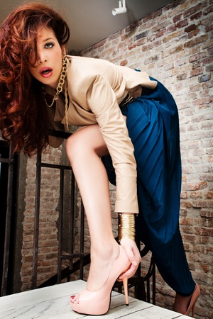high heels woman: attractive fashion woman pose on stairs indoor shot Stock Photo