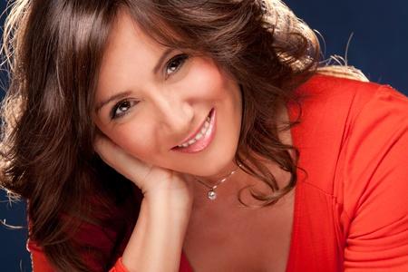 woman close up: smiling mature woman portrait close up studio shot