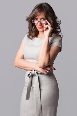 mature elegant businesswoman in gray dress studio shot Stock Photo - 13055525