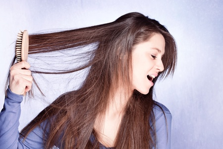 nervousness: woman  frustrated with  her hair