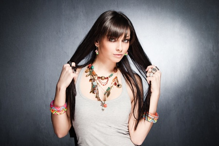 young blue eyes fashion girl portrait with lot of necklaces, rings and bracelets studio shot Stock Photo - 13198054