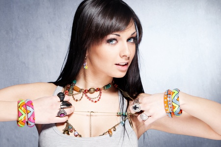 girl with rings: cute  girl with lot of necklaces, bracelets and rings studio shot Stock Photo