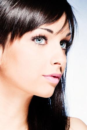 black hair blue eyes: girl with beautiful blue eyes portrait studio shot