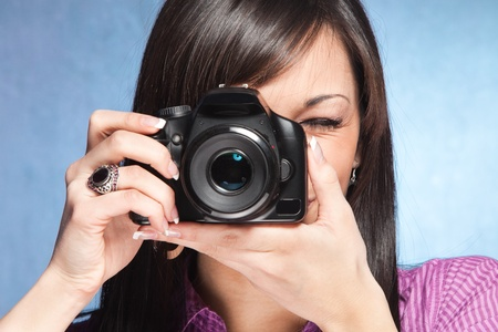 shootting: girl take a photo with digital camera