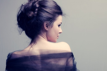woman back: elegant woman with bun, back view profile, studio shot
