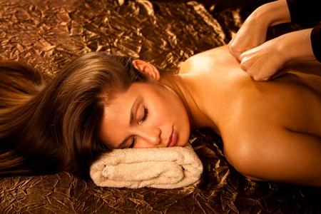 back massage: woman enjoy in  back massage in spa Stock Photo