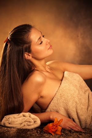 towels luxury:  young woman enjoy in spa