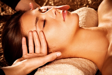 woman getting  face  massage in spa  photo