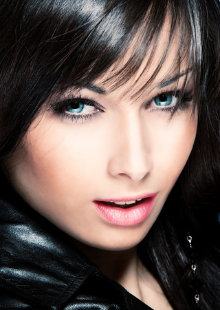 beautiful black hair young woman with blue eyes photo