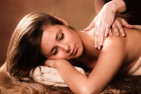 woman enjoy in  back massage in spa photo