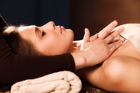 woman getting neck  massage in spa photo