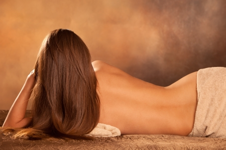 beautiful woman back lie in spa salon photo