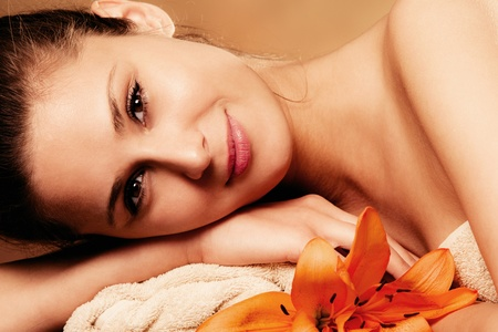 smiling natural beautiful woman in spa salon, relaxing, portrait  photo