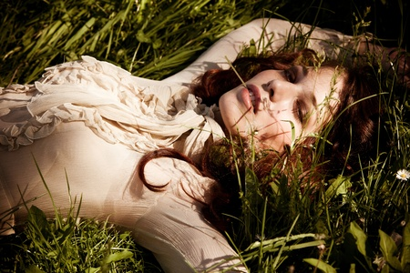 elegant woman lie in grass portrait, summer day photo