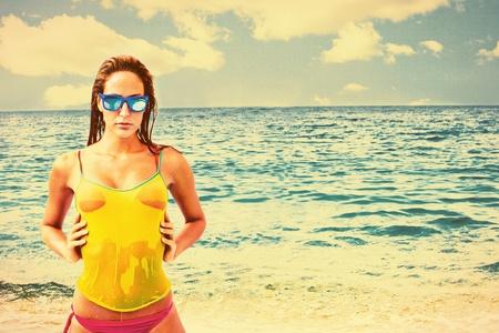 wet t shirt: girl in wet t-shirt and bikini wearing sunglasses at  sea beach