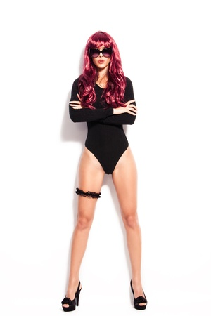 attractive young woman with red wig and sunglasses in black body, full body shot, studio white photo