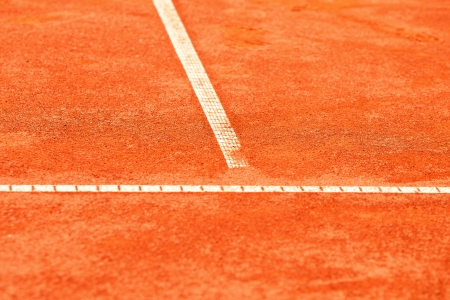 red clay: clay tennis court with white lines