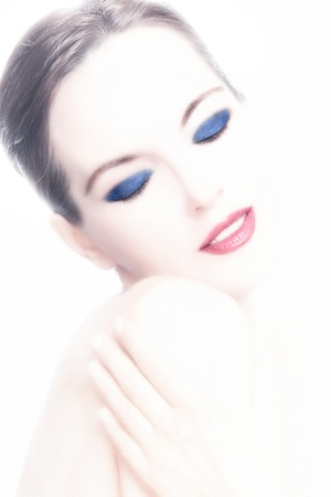 overexposed: mature woman with strong makeup and intentionaly overexposed skin small amount of grain added Stock Photo