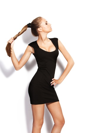 tight dress: natural blond hair young woman pose in studio on white