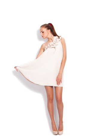 white dress: young woman in elegant dress full body shot studio white  Stock Photo