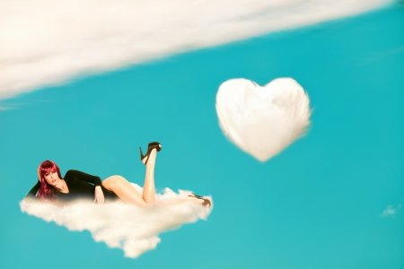 sexy redhead young woman lying on cloud photo compilation grain added photo