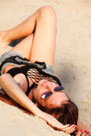 young  woman enjoy in sunset in sand summer day photo
