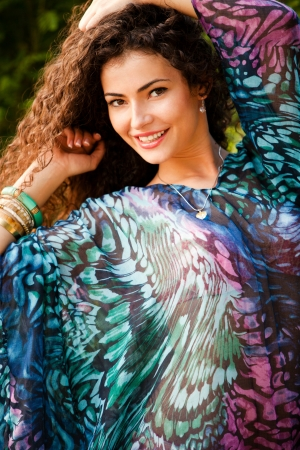 curly hair smiling woman portrait outdoor summer day