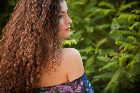 woman profile face: curly hair woman portrait outdoor profile