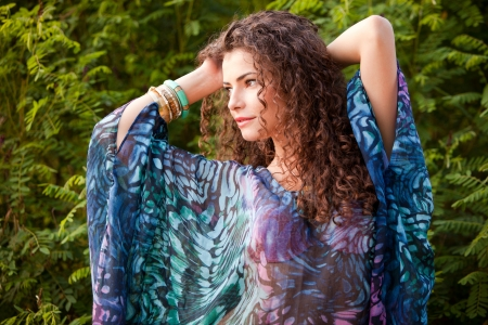 curly hair woman: curly hair woman portrait outdoor summer day