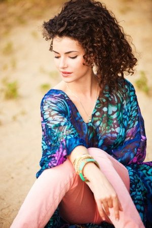 curly hair smiling woman portrait outdoor summer day photo