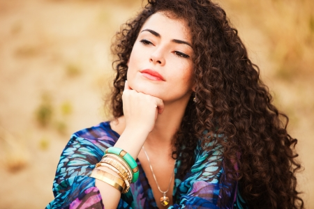 curly hair woman portrait outdoor summer day photo