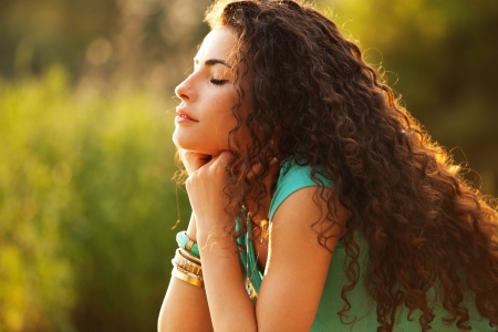 curly hair woman: young curly hair woman enjoy in summer sun