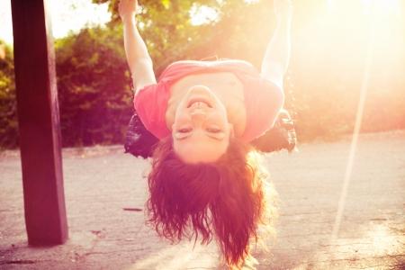 happy: happy teen girl have fun on  swing sun flare Stock Photo