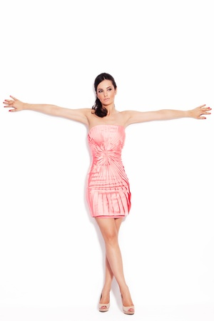 adult pretty woman in elegant short dress and high heel shoes on white background photo