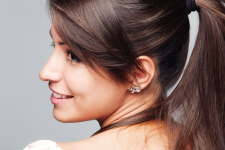 ponytail: young woman with ponytail profile  studio shot