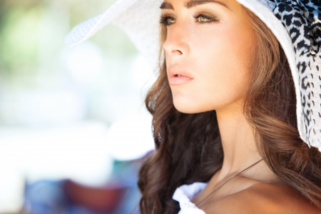 woman face profile: young elegant woman outdoor portrait with hat summer day