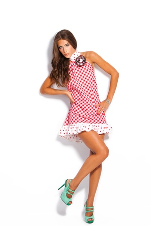 young fashion model in summer dress and high heel shoes studio white photo
