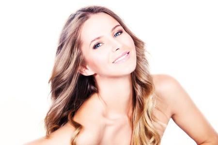 long shot: smiling beautiful long hair blond with blue eyes, studio shot white background
