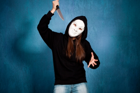 halloween girl with white  mask and big knife front view  Stock Photo - 15119028