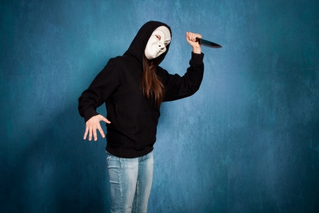 scary girl: halloween girl with white  mask and big knife side view