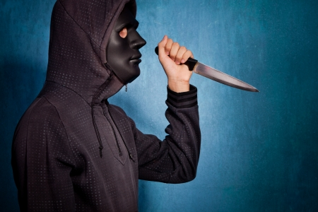 man with black scary mask and big knife  photo