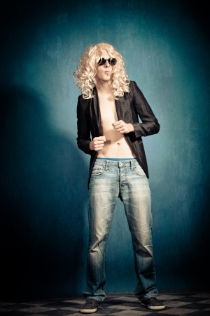 parody: heavy metal rock star man with long blond curly hair and sunglasses parody