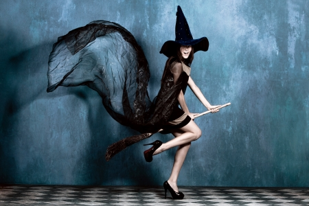 witches: teen witch on her broom ready to fly Stock Photo