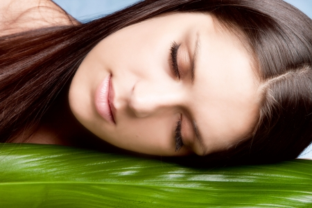 natural beauty woman portrait with leaf  eyes closed studio shot horizontal  Stock Photo - 15175452