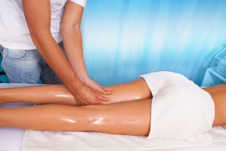 woman leg massage in health and spa center photo