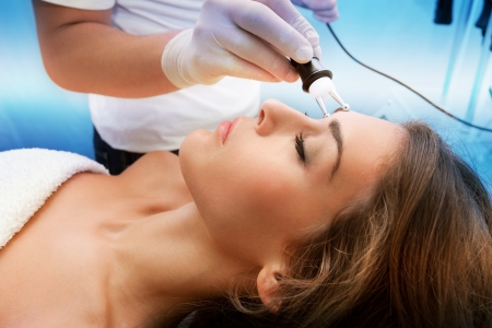 ultrasonic: woman face treatment in medical spa center
