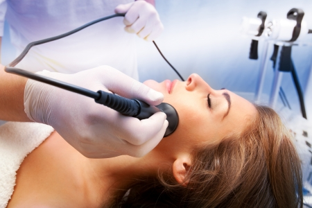 rejuvenation: woman face treatment in medical spa center