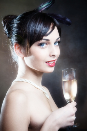 smiling beautiful elegant blue eyes woman with glass of champagne  photo